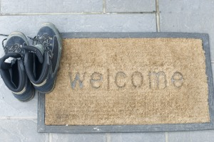 Welcome mat with walking shoes